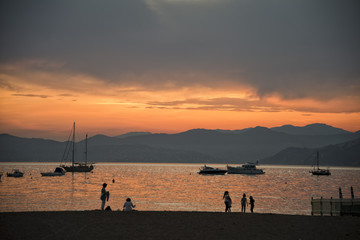 People on sestri levante beach at sunset
