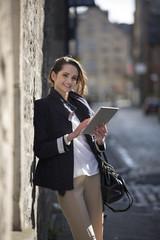 Modern Caucasian Business woman, using digital Tablet outside.
