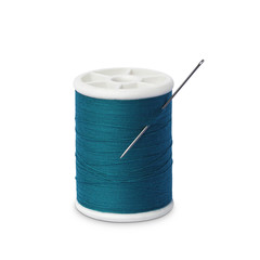 Spool of thread with needle isolated on white
