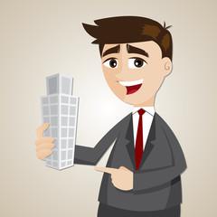 cartoon businessman holding building