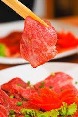Korean food Beef Sliced holding with chopstick