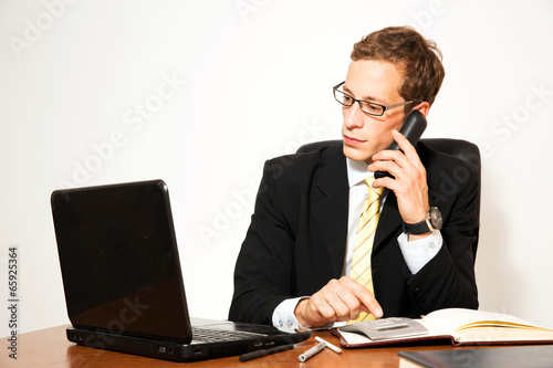 Business dressed male model working in office