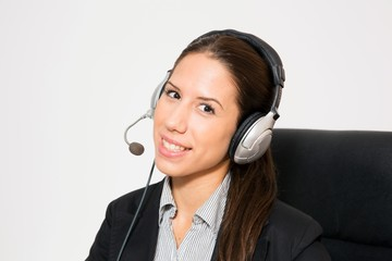 Young business dressed female, working as telemarketer.