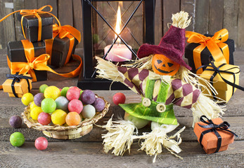 Halloween still life with candies, candle and doll