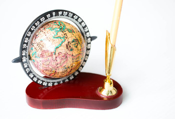 Globe and pen holding on white backgroun