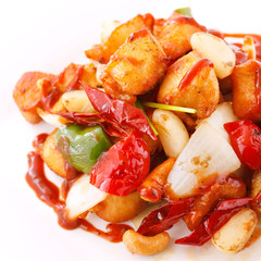 Stir fried chicken with cashew nuts isolated on white