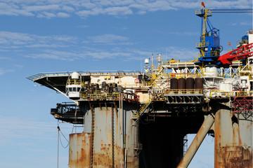 Old oil rig in harbor