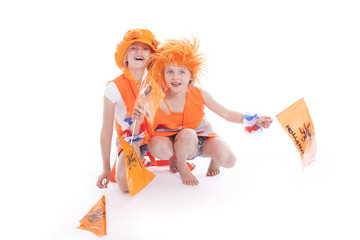 two girls in orange outfit cheer