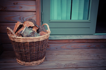 Basket of firewood on the porch