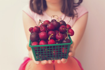 Cherries from market in child hands