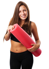 cute teenager holding a mat ready to do sport isolated on white