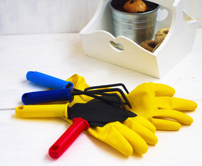 Gaderning tools and rubber gloves