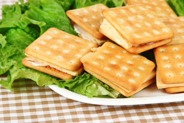 Sandwich crackers with cheese on tablecloth