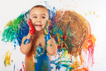 adorable kid paint stained representing the creativity and the f