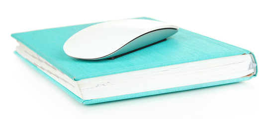 Computer mouse on book isolated on white