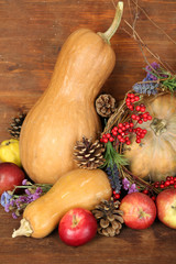 Autumn composition of apples, pumpkins, flowers and dry
