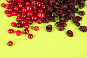 Fresh and dry cranberry on wooden table close-up