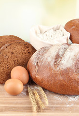 Composition with rye bread on table on light background