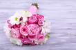 Beautiful wedding bouquet on wooden background