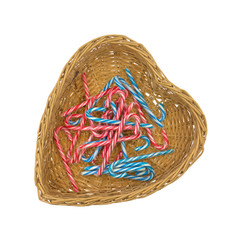 Several candy canes in heart shaped basket