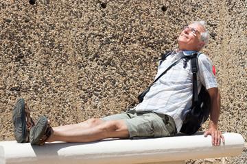 Senior man backpacker resting outdoors