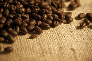 Coffee Beans spilling from a burlap gunney sack closeup