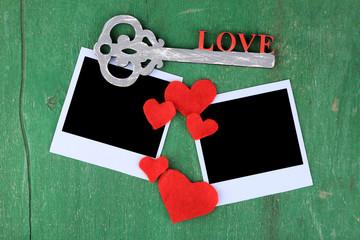 Blank old photos and decorative key, hearts