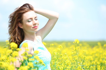 Beautiful young woman in flower field