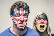Scary couple with British and German flag on face