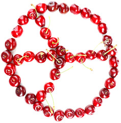 Sweet cherries making peace sign, isolated on white