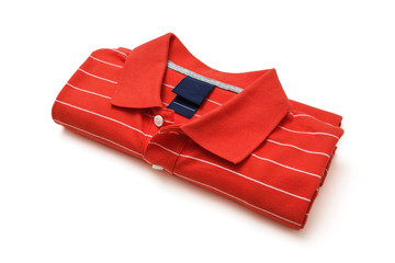 Folded red polo t-shirt isolated on white