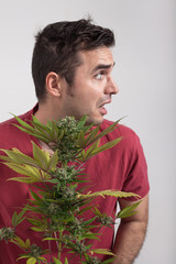 Scared man with Cannabis plant