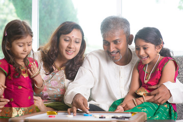 Indian family playing carrom game