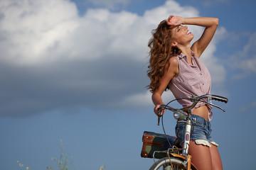 beautiful sexy girl next to the bike