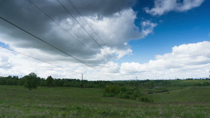 View of a power line with clouds floating over it- timelapse