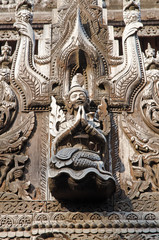 Carved figurines. Shwe Kyang monastery