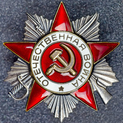Soviet Order of the Patriotic War of second degree on a granite