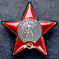 Order Red Star on a granite background
