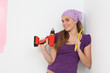 woman  with cordless electric drill and tape measure