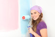 early pregnant woman deciding to paint nursery pink or blue.