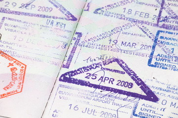 Close - up many international passport stamps