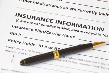 Close - up insurance information with a pen