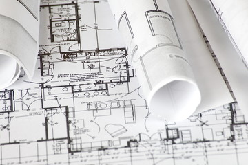 close - up Architect rolls and plans architectural plan