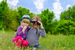 Two young children playing with binoculars