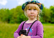 Young girl wearing a hat with binoculars