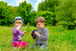 Little girl and boy playing with binoculars