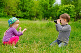 Young boy and girl playing with binoculars