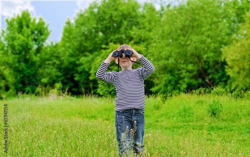 Young kid playing with binoculars
