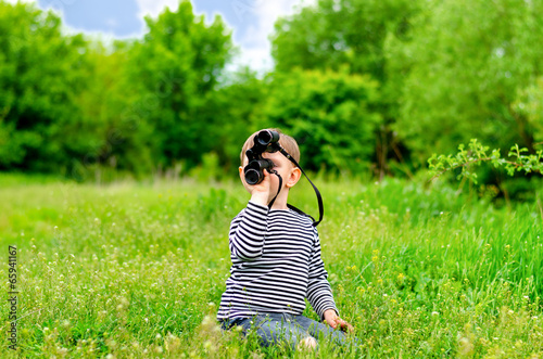 Young kid playing with binoculars