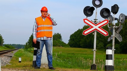 Railroad worker with cell phone near signal beacons episode 2